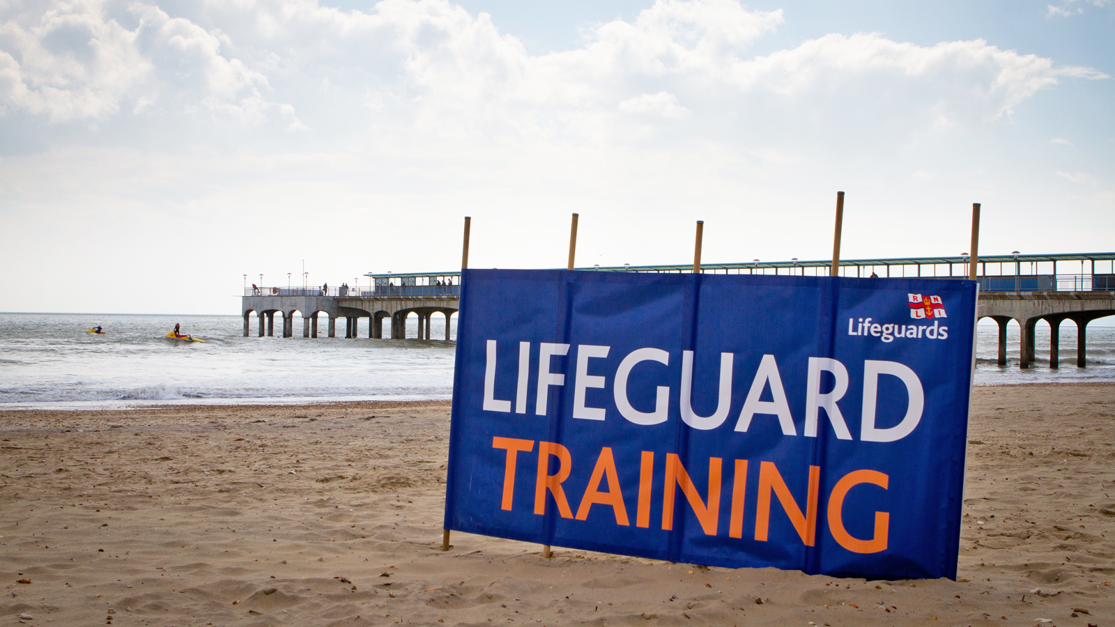 Lifeguard training sign on the beach