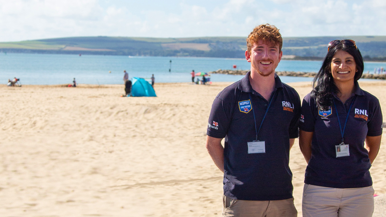 Two RNLI face to face fundraisers on a beach
